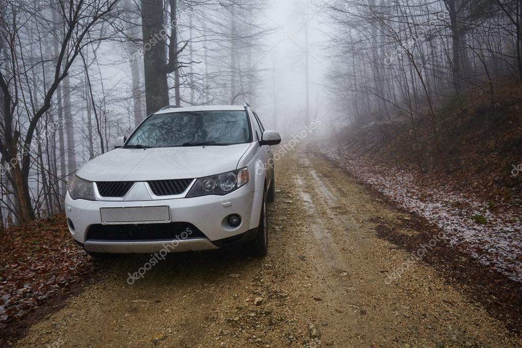 depositphotos_101947602-stock-photo-suv-offroad-on-a-foggy